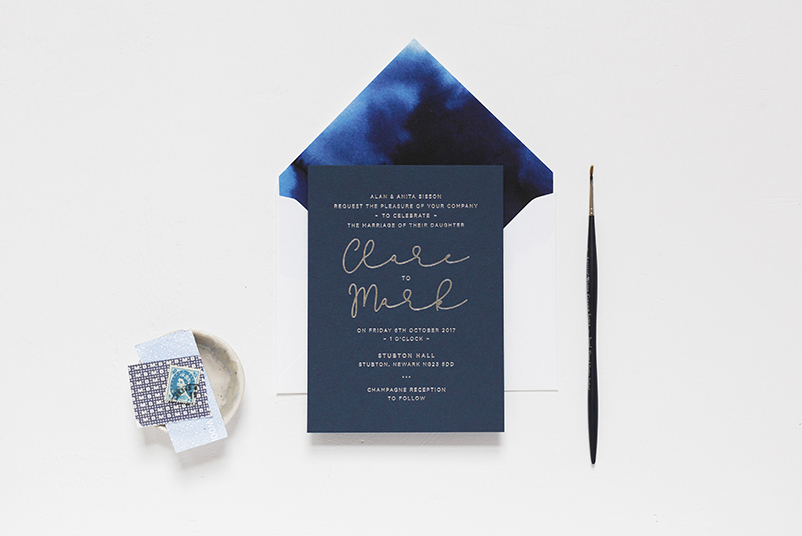 Navy and silver invitations and stationery