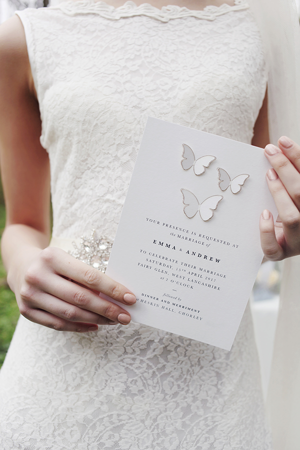 Laser cut wedding invitation featuring 3D butterflies.